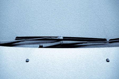 windscreen: Close-up shot of a cars windscreen wiper covered in snow