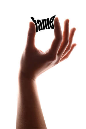 renown: Color vertical shot of a hand squeezing the word fame. Stock Photo
