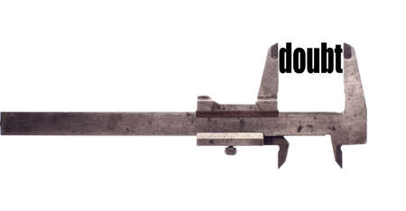 disbelief: Color horizontal shot of a caliper measuring the word doubt. Stock Photo