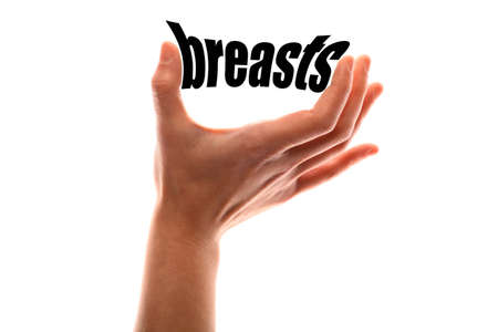 artistic nude: Color horizontal shot of a of a hand squeezing the word breasts. Stock Photo