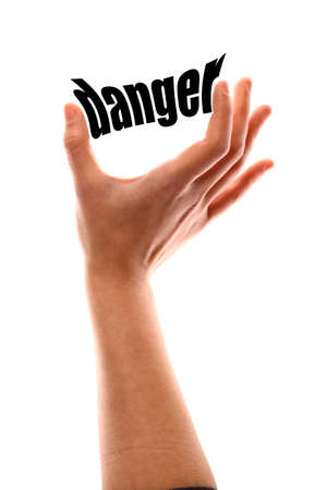 exact: Color vertical shot of a of a hand squeezing the word danger.