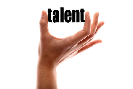 exact: Color horizontal shot of a hand squeezing the word talent. Stock Photo