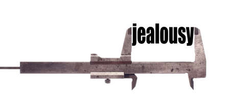 jealousy: Color horizontal shot of a caliper and measuring the word jealousy. Stock Photo