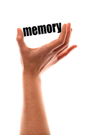 recollection: Color vertical shot of a of a hand squeezing the word memory. Stock Photo