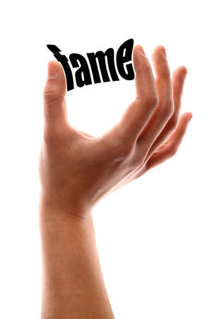 celebrities: Color vertical shot of a hand squeezing the word fame. Stock Photo