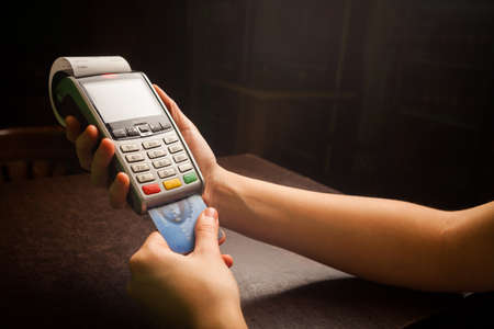 Color image of a POS and credit cards. Foto de archivo