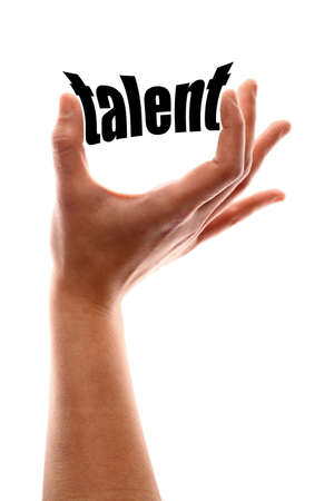 qualified: Color vertical shot of a hand squeezing the word talent.