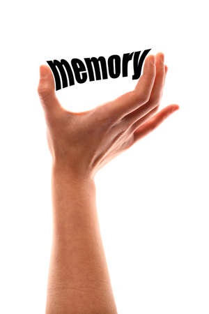 aging brain: Color vertical shot of a of a hand squeezing the word memory. Stock Photo