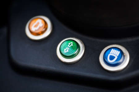 the detail: Color detail image of a motorcycle turn signal indicator.