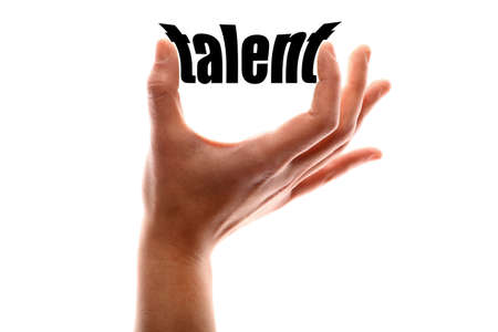 talented: Color horizontal shot of a hand squeezing the word talent. Stock Photo