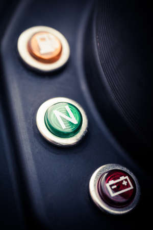 light transmission: Color close up image of the neutral switch indicator on a motorcycle.