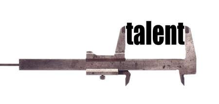 caliper: Color horizontal shot of a caliper measuring the word talent.