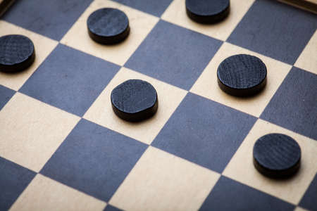 draughts: Color shot of a vintage draughts or checkers board game.