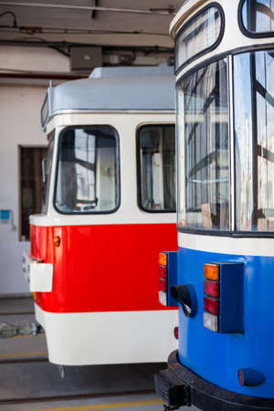 depot: Color image of some trams in a tram depot.