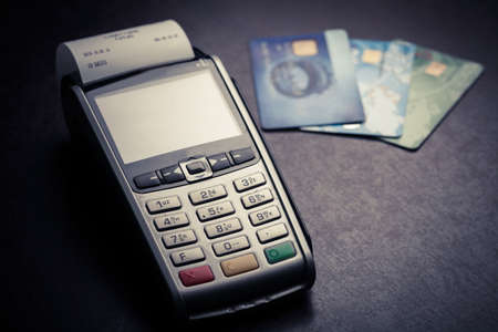 debit card: Color image of a POS and credit cards. Stock Photo