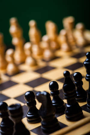 battle plan: Close-up image of a chess board with chess pieces. Stock Photo