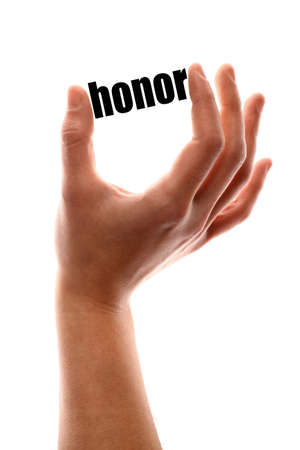 prestige: Color vertical shot of a hand squeezing the word honor.