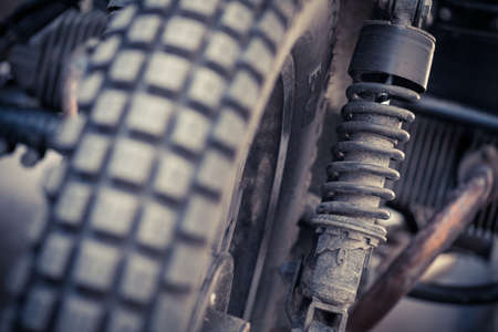 springy: Color horizontal shot of a vintage motorcycle suspension. Stock Photo