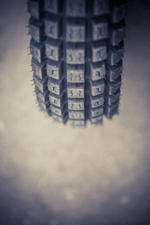 tyre tread: Color image of an off-road trial motorcycle tire.