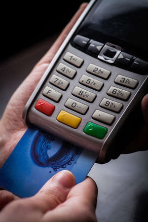 pos: Color image of a POS and credit cards. Stock Photo