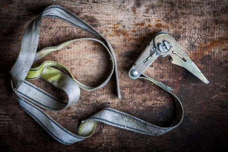 ratchet: Color image of some ratchet tie down on a wooden plank. Stock Photo