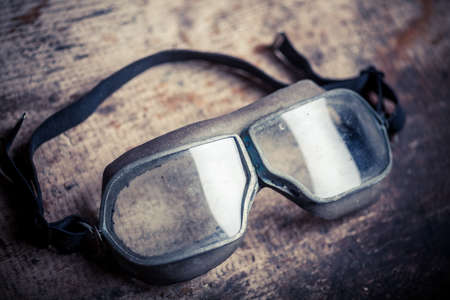 Color image of some old used goggles.