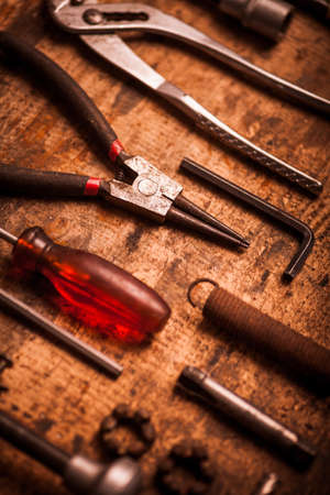 allen key: Color image of many tools on a wooden plank.