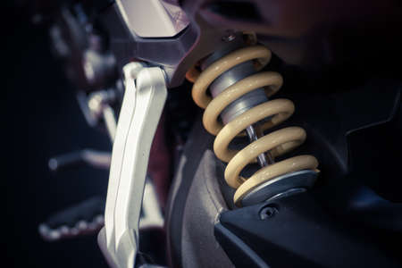 springy: Color shot of a motorcycle shock absorber. Stock Photo