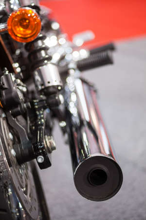 exhaust: Color image of a motorcycle exhaust pipe.