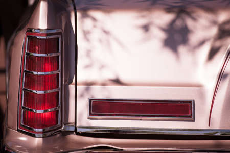 taillight: Detail on the rear light of a vintage car. Stock Photo