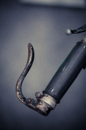 palanca: Color detail shot of the clutch lever on a vintage motorcycle. Foto de archivo