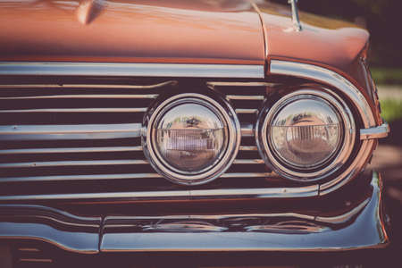 circular muscle: Color detail on the headlight of a vintage car. Stock Photo