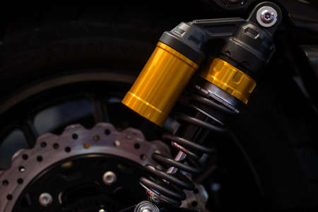 absorber: Color shot of a motorcycle shock absorber. Stock Photo