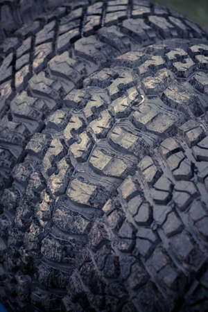 knobby: Color close up of some wet knobby car tires. Stock Photo