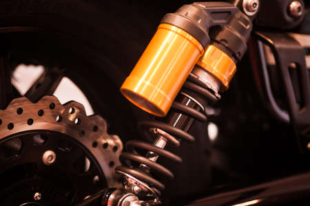 shock absorber: Color shot of a motorcycle shock absorber. Stock Photo