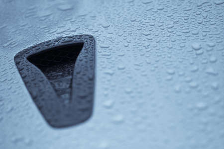 intake: Color image of an air intake scoop on a car. Stock Photo
