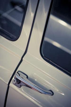 door handle: Color image of an old car door handle.