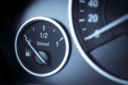 fueling pump: Close-up horizontal shot of a diesel fuel gauge in a car. Stock Photo