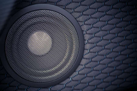 Close up shot of a round speaker in a car. Stock Photo