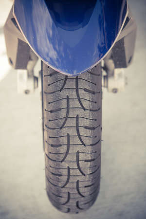 tyre tread: Close up shot of a motorcycle wheel with fender.