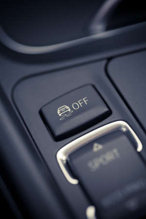 esp: Close up shot of the ESP button in a car.