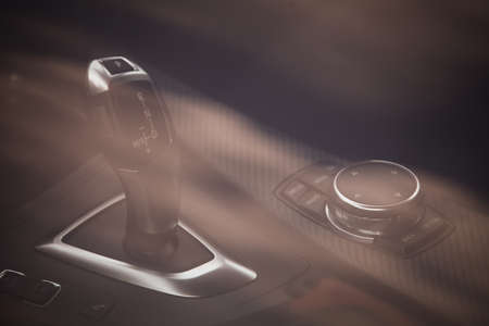gearstick: Close up shot of a gear stick inside a car.