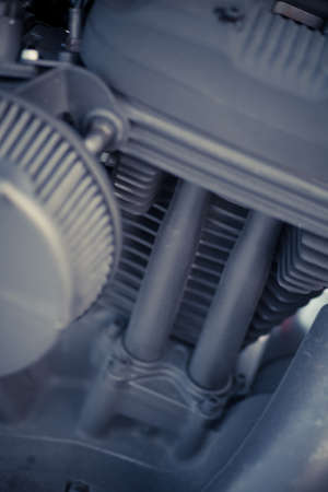 cylinder block: Close up shot of the engine of a motorcycle.