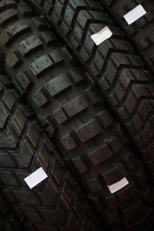 treads: Close up shot of some new motorcycle tires.