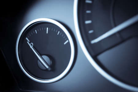 fuel gauge: Close-up horizontal shot of a fuel gauge in a car. Stock Photo