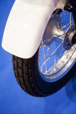 fender: Close up shot of a motorcycle wheel with fender.