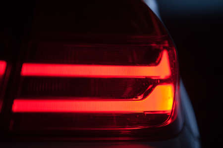 brake: Detail on the rear light of a car.