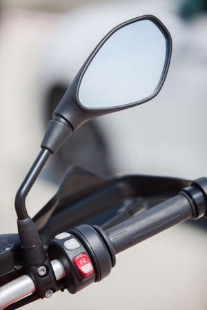 controls: Color image with the controls on a motorcycle handlebar and a mirror. Stock Photo
