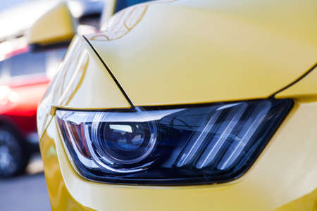 headlamp: Detail on one of the LED headlights of a car. Stock Photo