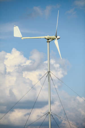 wind mill: Color image of a wind vane on a sunny day. Stock Photo